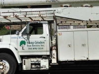 Stump Grinders Tree Service, Inc. Crane Truck