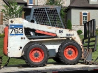 Stump Grinders Tree Service, Inc. Bobcat